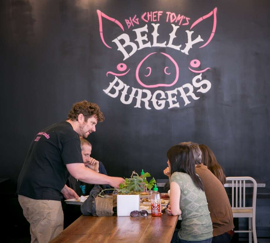 Owner Tom Pizzica serves food to customers at Big Chef Tom's Belly Burgers in San Francisco, Calif., on Wednesday, July 17th, 2014. Photo: John Storey, Special To The Chronicle