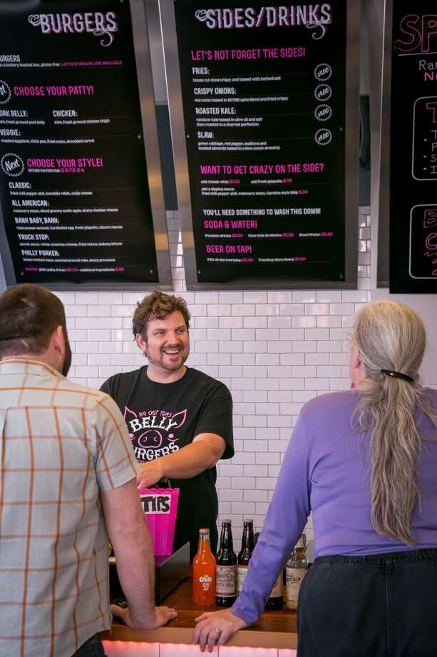Owner Tom Pizzica takes orders from customers at Big Chef Tom's Belly Burgers in San Francisco, Calif., on Wednesday, July 17th, 2014. Photo: John Storey, Special To The Chronicle