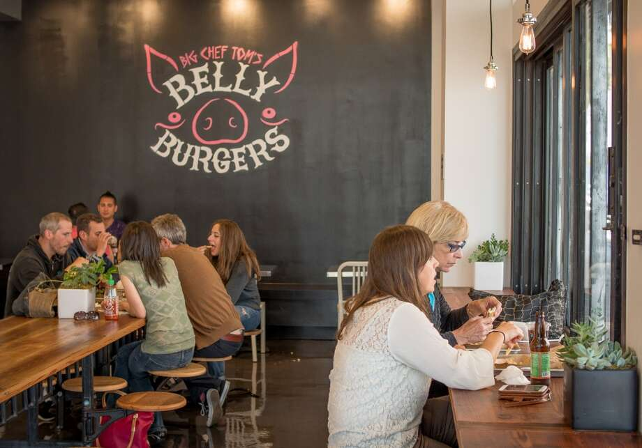 People have lunch at Big Chef Tom's Belly Burgers in San Francisco, Calif., on Wednesday, July 17th, 2014. Photo: John Storey, Special To The Chronicle