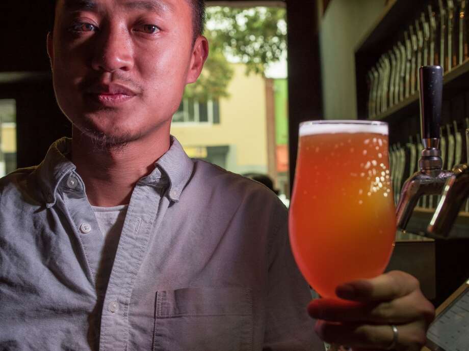 "Brewer/owner Viet Vu with ""Saison"" at Hoi Polloi in Berkeley, Calif., is seen on Thursday, July 18th, 2014. Photo: John Storey, Special To The Chronicle"
