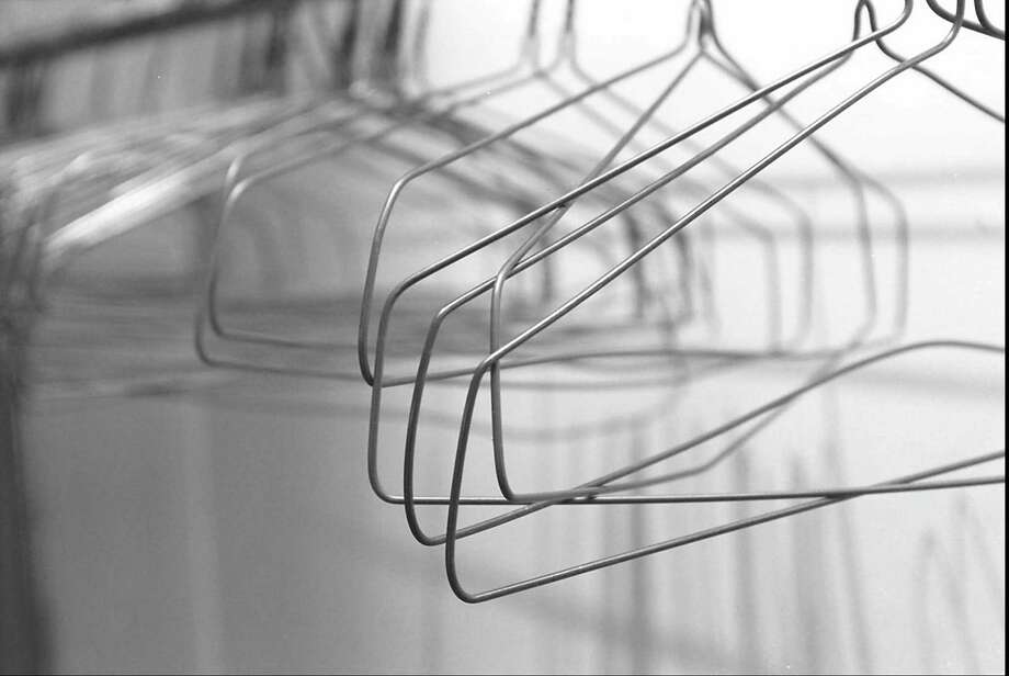 """""""When Iíd pull out a garment to hold it up to me, three adjacent hangers would jump aboard,"""" says Beth Dolinar. Photo: Contributed Photo, GT / Greenwich Time Contributed"""