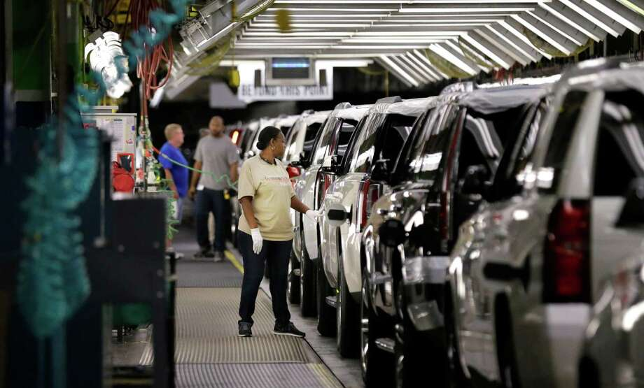 FILE - In this May 13, 2014 file photo, an auto worker inspects finished SUVs coming off the assembly line at the General Motors auto plant in Arlington, Texas. General Motors reports quarterly financial results on Thursday, July 24, 2014. (AP Photo/LM Otero, File) Photo: LM Otero, STF / AP