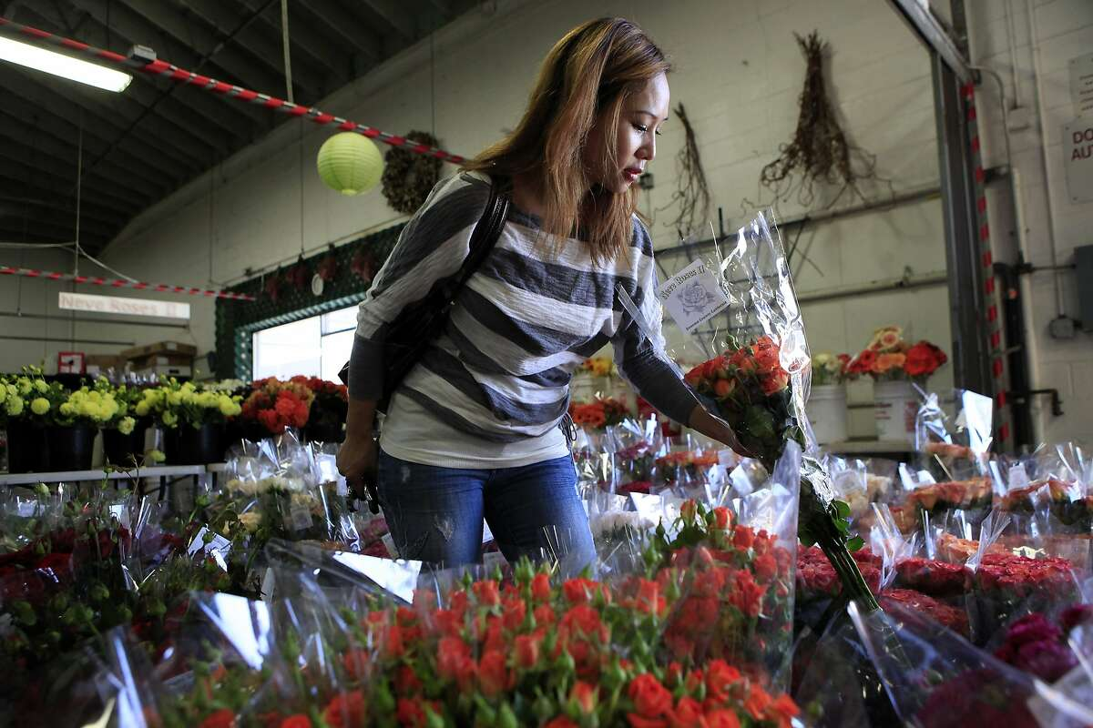 Designer Kimberly Lau of Bings Design shops for flowers at Neve Roses in the Flower Mart in San Francisco, CA, Thursday, July 24, 2014.