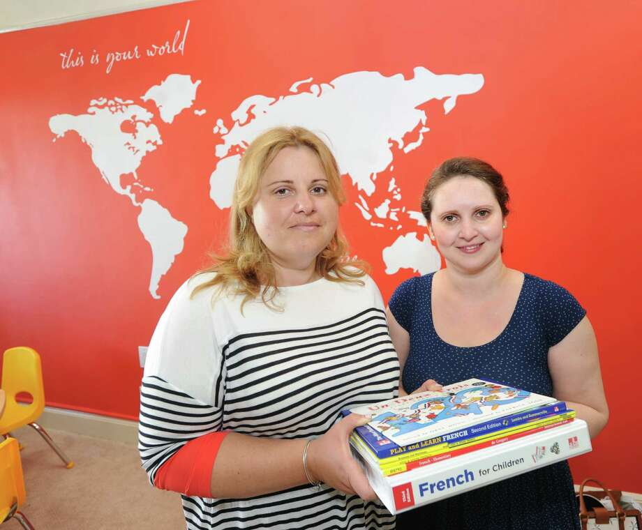 At left, Irina Markevich of Cos Cob, and Galina Dubrovina, of Greenwich, co-founders of The Rainbow of Languages, during the grand opening of their company that provides foreign language lessons to people ages 6 months and up, at their office space in central Greenwich, Thursday, July 24, 2014. Photo: Bob Luckey / Greenwich Time