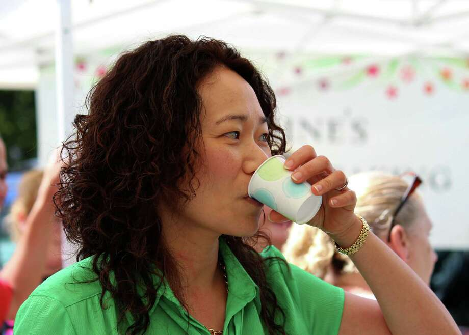 Yimei Han of Schenectady participates in the 2014 Schenectady County best tasting drinking water competition on Thursday afternoon, July 24, 2014, in Schenectady N.Y. (Selby Smith/Special to the Times Union) Photo: Selby Smith / 00027895A