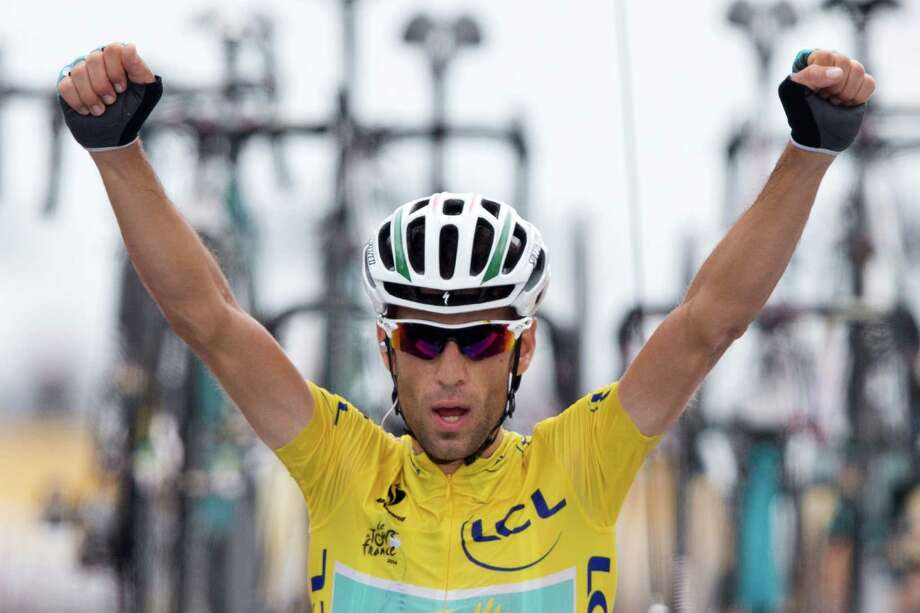 Italy's Vincenzo Nibali crosses the finish line to win the eighteenth stage of the Tour de France cycling race over 145.5 kilometers (90.4 miles) with start in Pau and finish in Hautacam, Pyrenees region, France, Thursday, July 24, 2014. (AP Photo/Peter Dejong) ORG XMIT: PDJ127 Photo: Peter Dejong / AP 2014