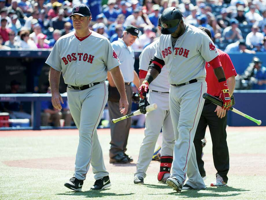 Boston Red Sox manager John Farrell, left, walks back to the dugout with designated hitter David Ortiz, right, after Ortiz injured himself in the ninth inning of a baseball game against the Toronto Blue Jays in Toronto on Thursday, July 24, 2014. (AP Photo/The Canadian Press, Nathan Denette) ORG XMIT: NSD120 Photo: Nathan Denette / CP