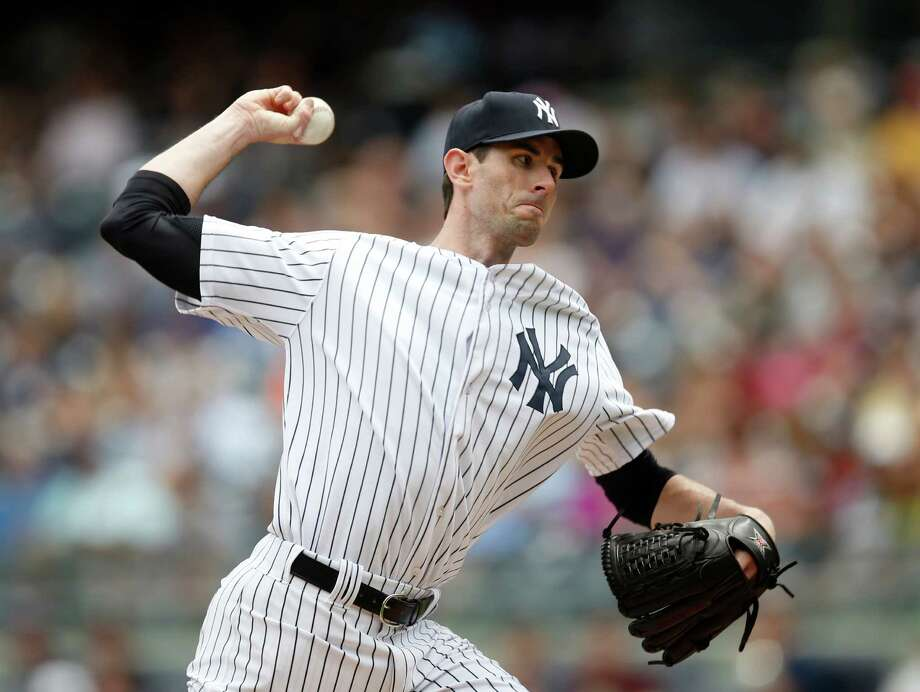 New York Yankees starting pitcher Brandon McCarthy (38) delivers in the first inning of a baseball game against the Texas Rangers at Yankee Stadium in New York, Thursday, July 24, 2014.  (AP Photo) ORG XMIT: NYY101 / AP