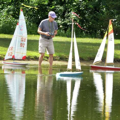 Peter Meixner of Clifton Park readies his boat for a Capital Region Model Boat Association race at The Crossings of Colonie Thursday July 24, 2014, in Colonie, NY.  (John Carl D'Annibale / Times Union) Photo: John Carl D'Annibale / 00027922A