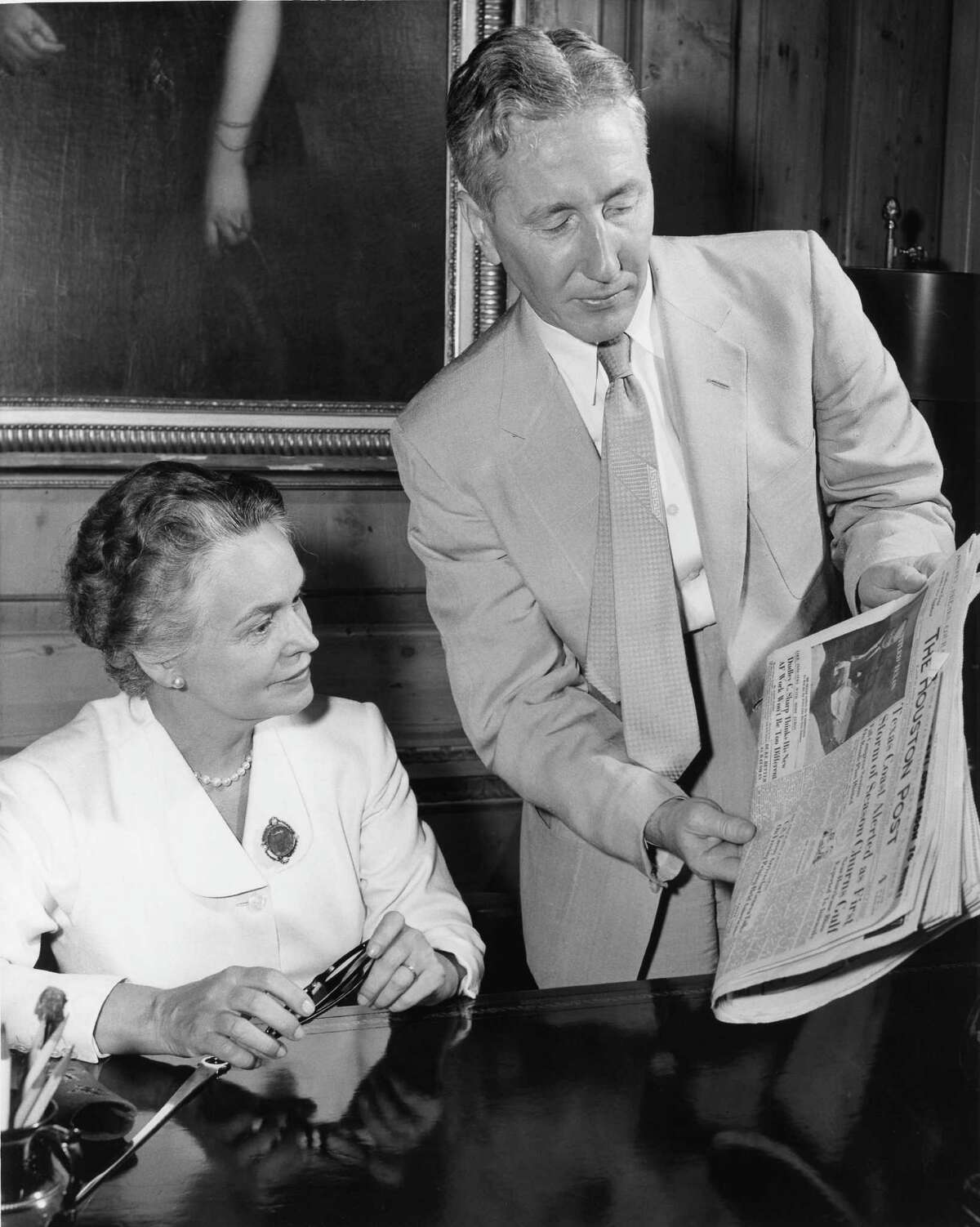 08/1955 - Oveta Culp Hobby, The Houston Post president and editor, is shown the front page of the paper by W. Howard Baldwin, vice-president and general manager of The Houston Post.