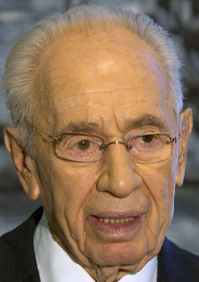 In handing over the presidency, Shimon Peres said he didn't imagine he would be trying to comfort grieving families in recent days. / AP