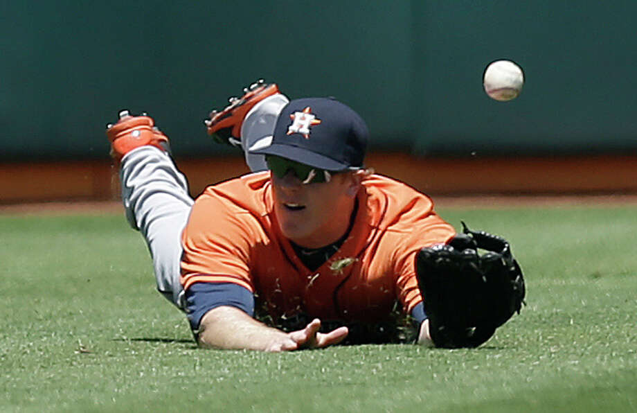 Houston Astros' Marc Krauss cannnot make the catch on a ball which fell for a double hit by Oakland Athletics' Josh Reddick in the third inning of a baseball game on Thursday, July 24, 2014, in Oakland, Calif. (AP Photo) Photo: Associated Press / AP