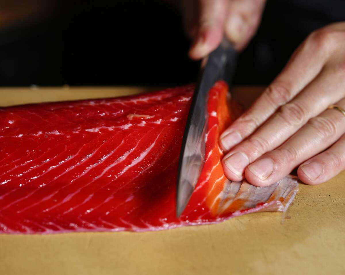 Sho Kamio of Iysasare beet cured trout on Thursday, July 17, 2014 in Berkeley, Calif.