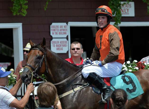 Jockey Kieran Norris sits sits atop Awesome Pearl in the winner's circle after winning The Jonathan Kiser Novice Stakes, the first race on the card, Thursday morning July 24, 2014 at the Saratoga Race Course in Saratoga Springs, N.Y.      (Skip Dickstein / Times Union) Photo: SKIP DICKSTEIN