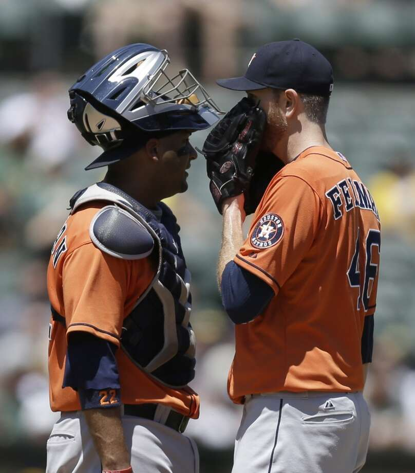 July 24: Athletics 13, Astros 1  Scott Feldman, right, speaks with catcher Carlos Corporan in the third inning. Photo: Associated Press