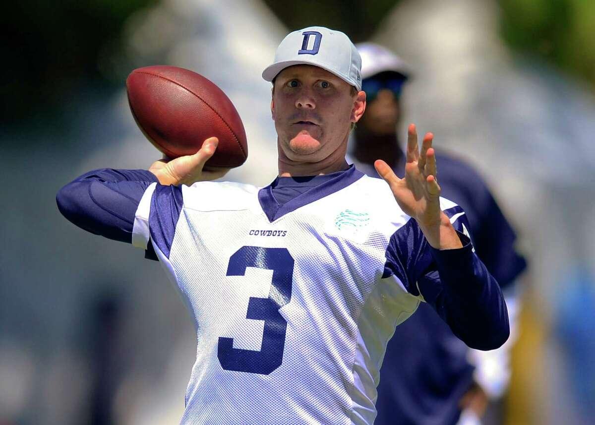 Dallas Cowboys quarterback Brandon Weeden throws a pass during NFL football training camp, Thursday, July 24, 2014, in Oxnard, Calif. (AP Photo/Gus Ruelas)