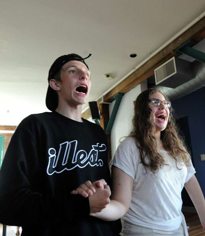 Actors, Django Vaz, 17, left, and Meredith Martin, 18, during the Off-Beat Players rehearsal of Spamalot at the Arch Street Teen Center, Greenwich, Conn., Thursday night, July 24, 2014. The Off-Beat Players is a long-running theater program that brings together children both with and without special needs in all roles of the show. Spamalot will run August 6th through August 9th at the center. Photo: Bob Luckey / Greenwich Time