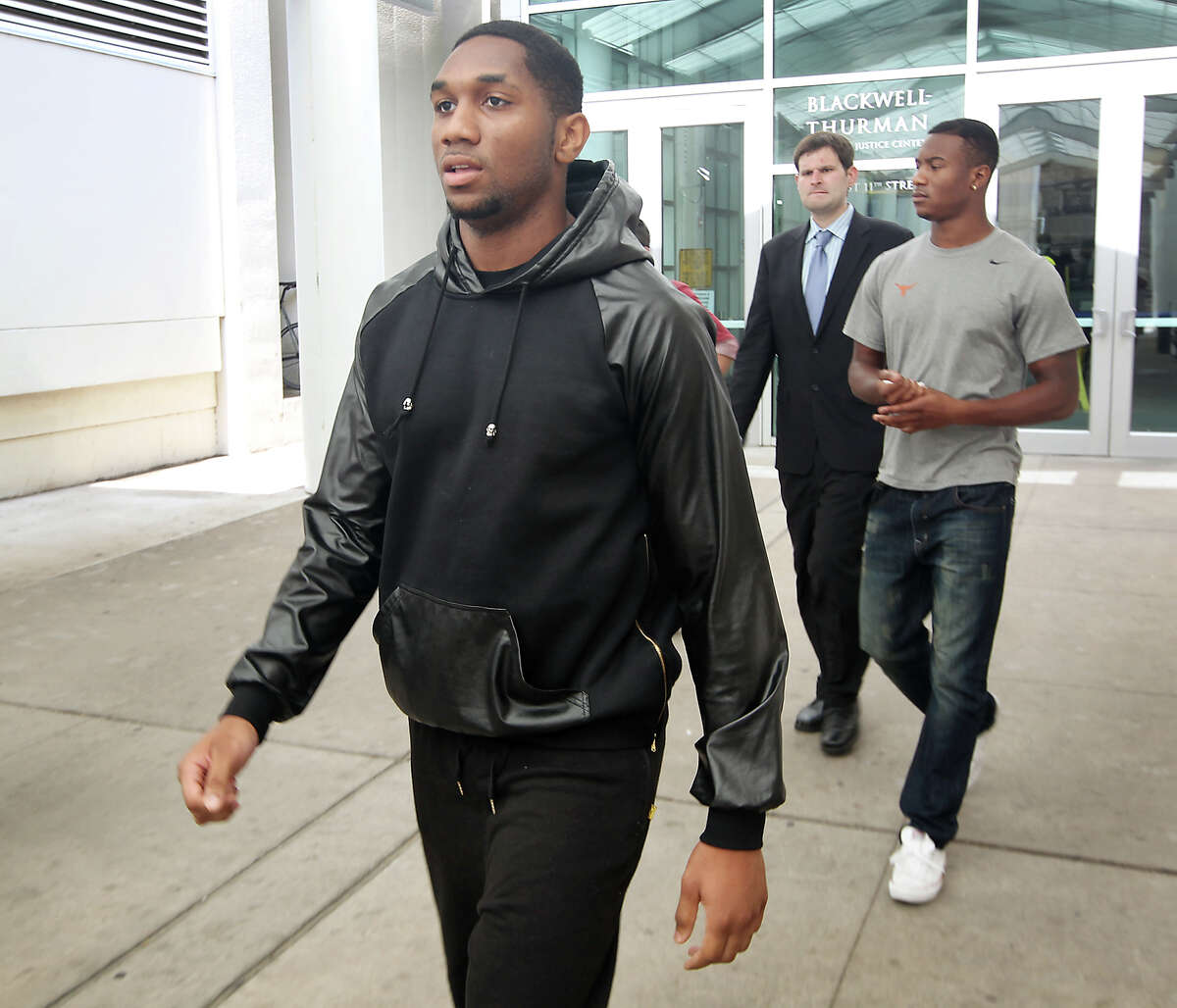 Dec. 15: Ex-UT players face rape charges Kendall Sanders and Montrel Meander, right, leave the Travis County Criminal Justice Center after being booked on July 24, 2014 in Austin.The two former University of Texas football players were charged with felony sexual assault after a female student said she was raped in a campus dorm room in June.Court date carries over into the new year
