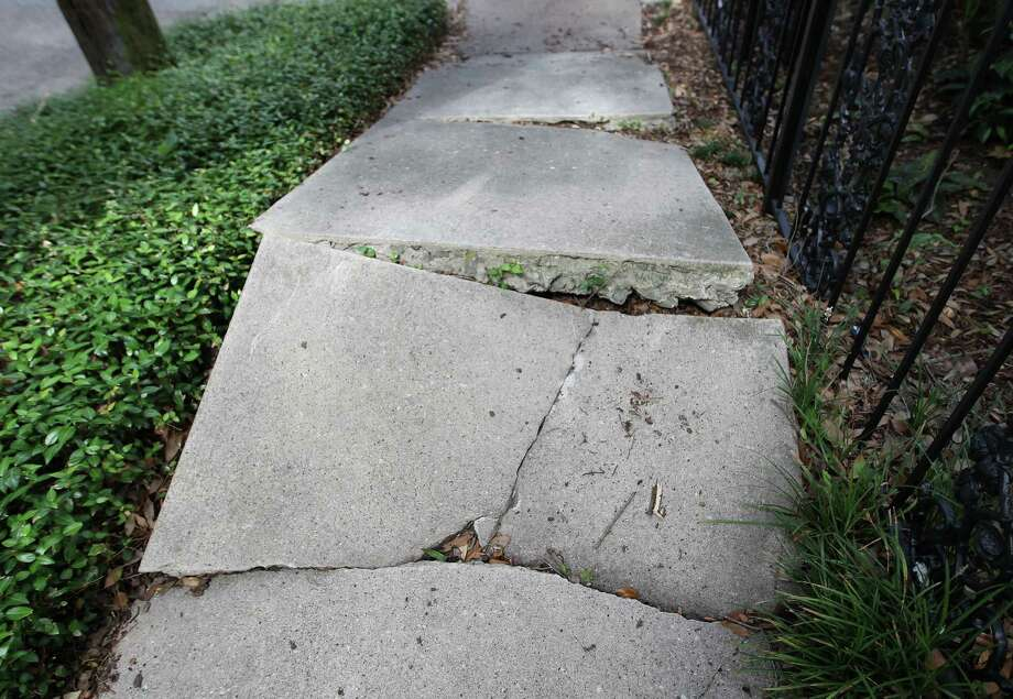 Houston sidewalks, when they exist, are often in terrible shape. (Scroll through the slideshow for more.) Photo: Karen Warren, Staff / © 2013 Houston Chronicle