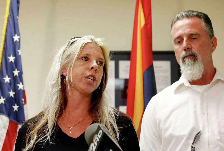 Family members of the victims, Jeanne Brown, left, who had a sister and father murdered, speaks during a news conference as her husband Richard Brown listens, after the nearly two hour long execution of Joseph Rudolph Wood at the state prison on Wednesday, July 23, 2014, in Florence, Ariz. (AP Photo)  ORG XMIT: AZRF107 / AP
