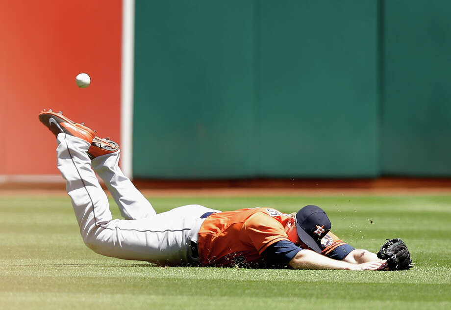 Astros left fielder Marc Krauss gets a face full of turf but no ball for his diving effort on a hit by Josh Reddick. Photo: Ezra Shaw, Staff / 2014 Getty Images