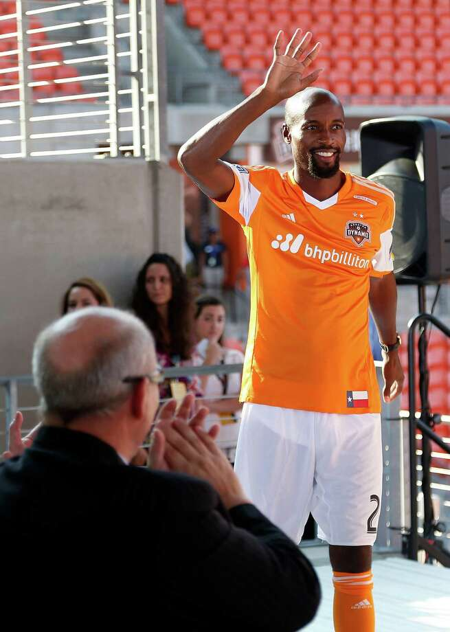 Houston Dynamo's new player DaMarcus Beasley waves to the crowd of fans during a press conference to introduce him at the BBVA Compass Stadium, Thursday, July 24, 2014, in Houston. Photo: Karen Warren, Houston Chronicle / © 2014 Houston Chronicle