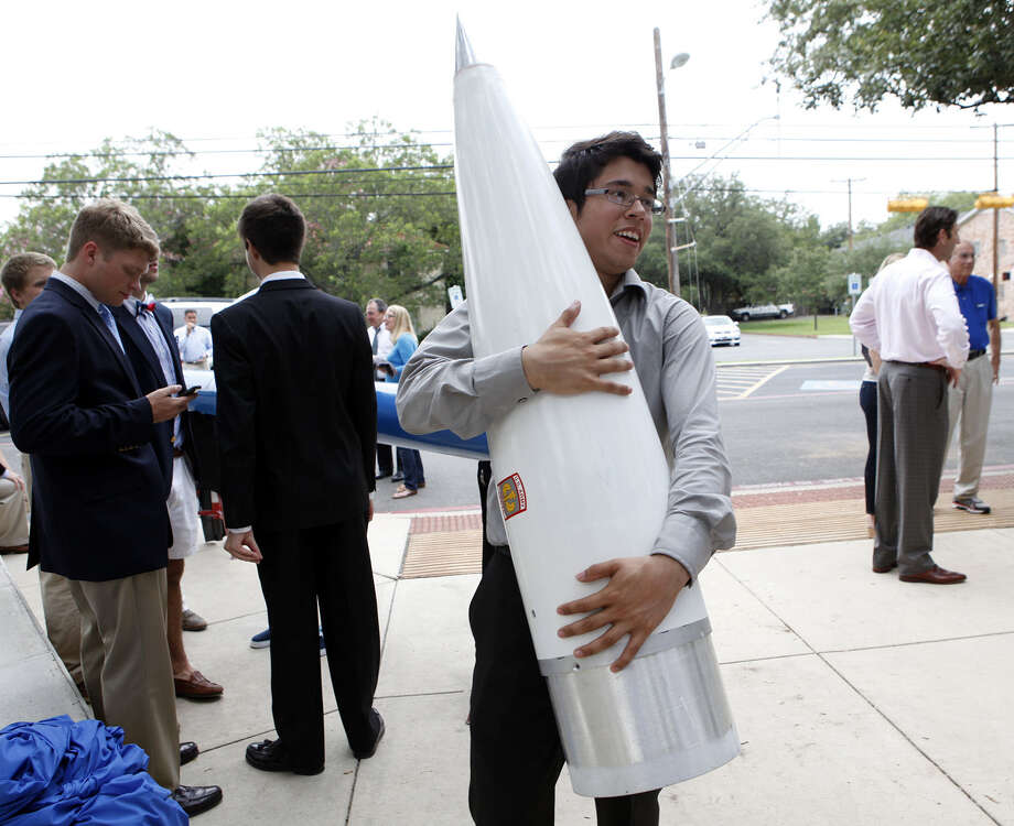 "Erick Castillon holds the nose cone that he built for the ""Eddie"" rocket during a reveal of the two rockets that about 40 students designed and built. Castillon spent 600 hours building the component from scratch. Photo: Cynthia Esparza / For The San Antonio Express-News / For the San Antonio Express-News"