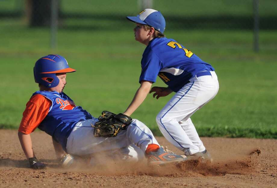 Photos from the Cal Ripken baseball league 11 year old, 70' diamond state championship game between Newtown and Danbury at Rogers Park in Danbury, Conn. Thursday, July 24, 2014. Photo: Tyler Sizemore / The News-Times