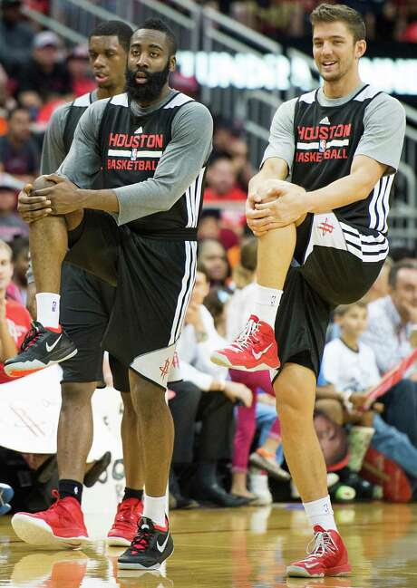 James Harden, left, and Chandler Parsons stretch during a Rockets open practice last fall, when the two were amiable teammates. Photo: Smiley N. Pool, Staff / © 2013  Houston Chronicle