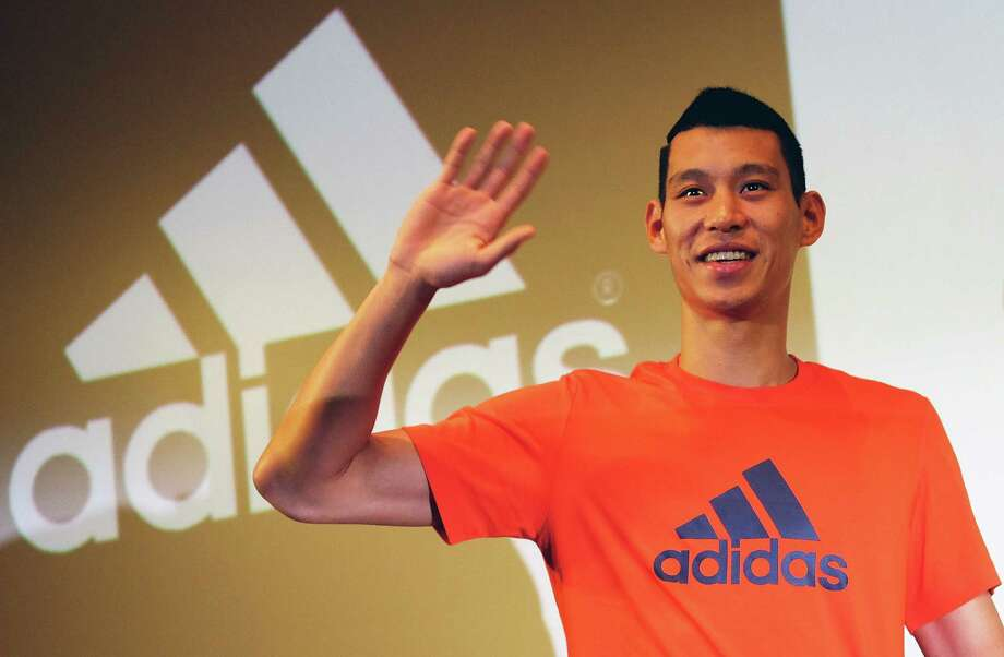 """NBA basketball player Jeremy Lin waves during a press conference in Taipei on July 18, 2014.  Lin, the point guard whose 2012 heroics for the New York Knicks sparked a brief """"Linsanity"""" phenomenon, said during a promotional tour in Taipei that he was very excited to join the Los Angeles Lakers after he was traded by Houston Rockets earlier this month.    AFP PHOTO / SAM YEHSAM YEH/AFP/Getty Images Photo: SAM YEH, Staff / AFP"""