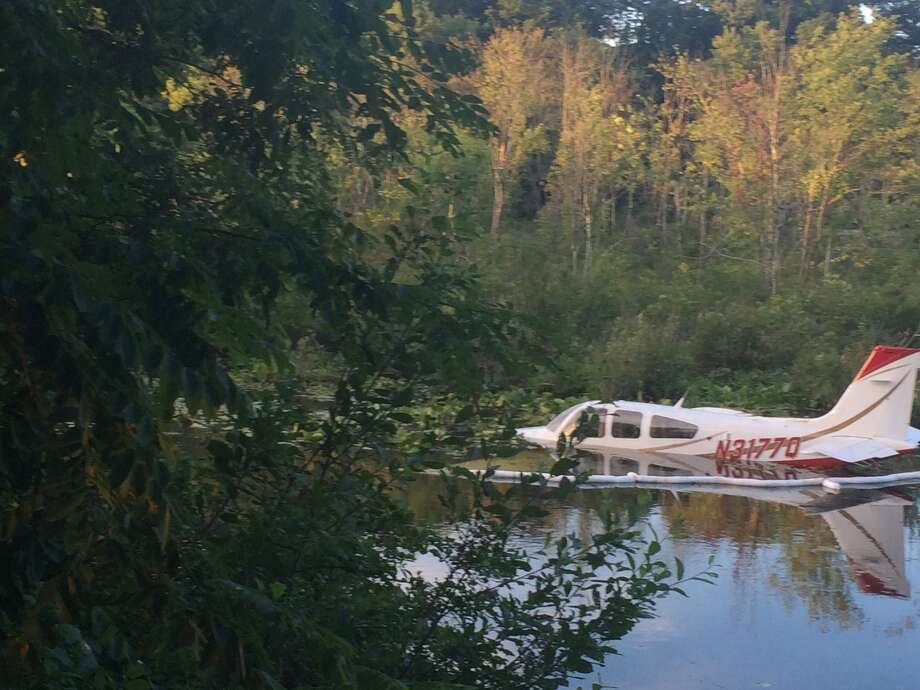 The scene of a plane crash in a swamp near the intersection of Miry Brook Road and Old Sugar Hollow Road in Danbury, Conn. Thursday, July 24, 2014. Photo: Contributed, Contributed Photo