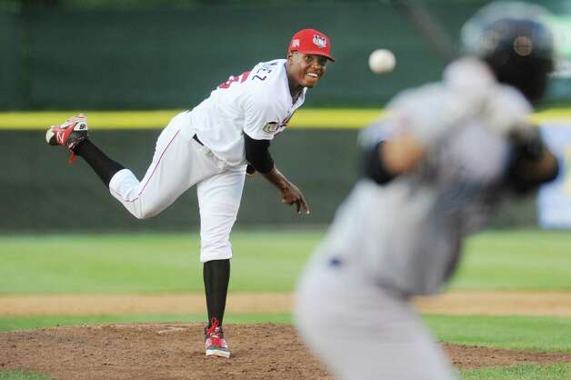 ValleyCats' Francis Ramirez releases a pitch during their baseball game against the Staten Island Yankees on Thursday, July 24, 2014, at Bruno Stadium in Troy, N.Y. (Cindy Schultz / Times Union) Photo: Cindy Schultz / 00027873A