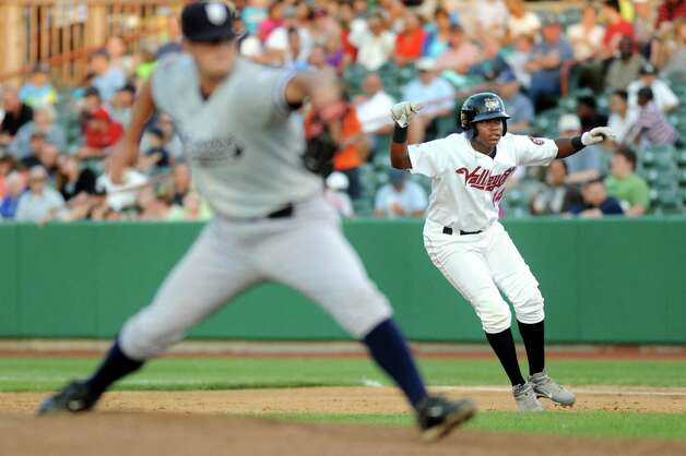 ValleyCats' Juan Santana, right, leads off first as Staten Island Yankees' Joseph Harvey winds up the pitch during their baseball game on Thursday, July 24, 2014, at Bruno Stadium in Troy, N.Y. (Cindy Schultz / Times Union) Photo: Cindy Schultz / 00027873A