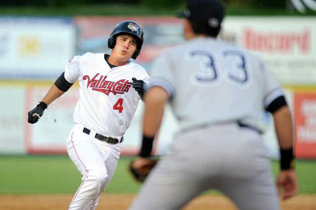 ValleyCats' Mott  Hyde, left, runs for third when he hits a triple during their baseball game against the Staten Island Yankees on Thursday, July 24, 2014, at Bruno Stadium in Troy, N.Y. Yankees' Renzo Martini defends. (Cindy Schultz / Times Union) Photo: Cindy Schultz / 00027873A