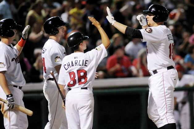 ValleyCats' A.J. Reed, right, celebrates his home run hit during their baseball game against the Staten Island Yankees on Thursday, July 24, 2014, at Bruno Stadium in Troy, N.Y. (Cindy Schultz / Times Union) Photo: Cindy Schultz / 00027873A