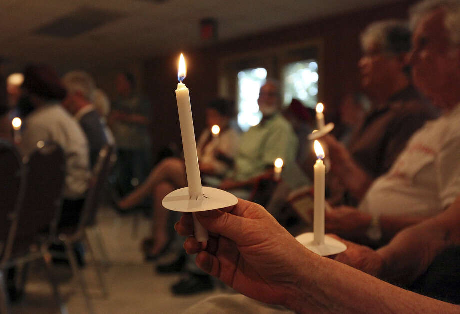 People pray for peace and healing for the Middle East at the Dr. Burton E. Grossman International Conference Center on the University of the Incarnate Word campus. Photo: Edward A. Ornelas / San Antonio Express-News / © 2014 San Antonio Express-News