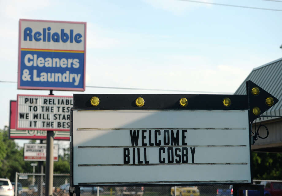 "A sign outside Reliable Cleaners and Laundry on 16th Street welcomes comedian Bill Cosby to Orange. Cosby performed to a sold out room at the Frances Ann Lutcher Theater in Orange on Thursday night. The comedian stopped in Orange for two nights on his ""é¢Ã©""¦ Far From Finished"" tour. Photo taken Thursday 7/24/14 Jake Daniels/@JakeD_in_SETX Photo: Jake Daniels / ©2014 The Beaumont Enterprise/Jake Daniels"