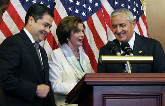 House Minority Leader Nancy Pelosi, D-Calif., chats with Honduran President Juan Hernandez (left) and Guatemalan President Otto Molina on Capitol Hill. Photo: Lauren Victoria Burke / Associated Press / FR132934 AP