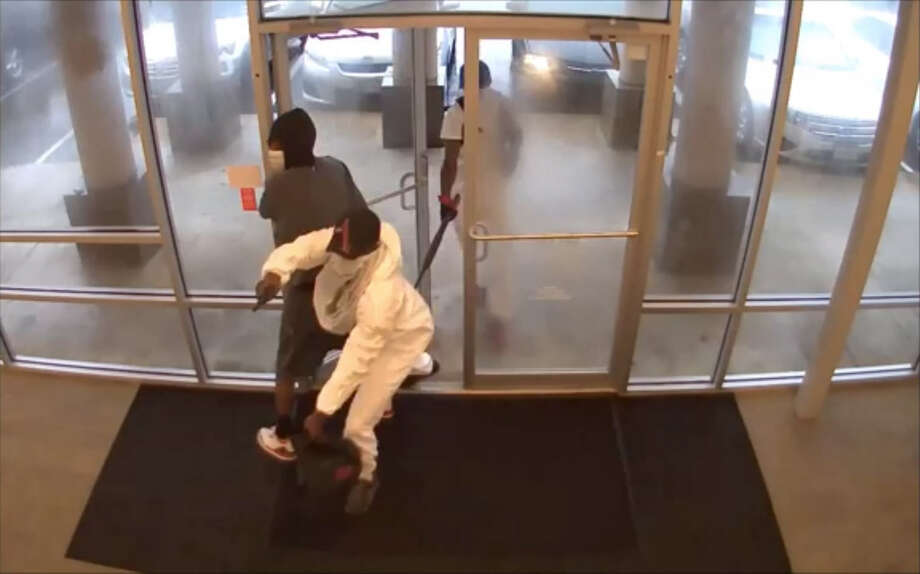 Houston police are searching for three masked gunmen who robbed a Sprint store at gunpoint on July 17. Investigators believe they may be responsible for similar robberies in the area, the most recent of which was asimilar armed robbery of a Harris County T-Mobile store on July 24, making off with approximately $30,000 in cellphones. (Houston Police) Photo: Houston Police Department