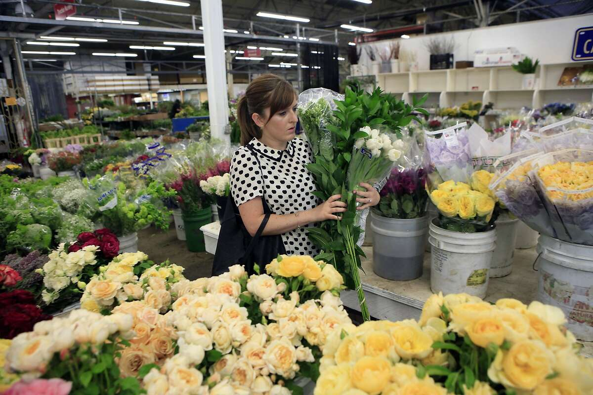 Erin Newman of Grant K. Gibson Interior Design shops for flowers at Torchio Nursery at the Flower Mart in San Francisco, CA, Thursday, July 24, 2014.