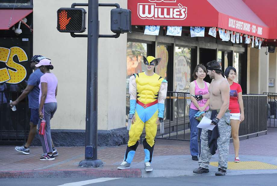 A fan dressed as Wolverine from the X-Men waits at a crosswalk on day 1 of the 2014 Comic-Con International Convention held Thursday, July 24, 2014 in San Diego. (Photo by Denis Poroy/Invision/AP) Photo: Denis Poroy, Associated Press