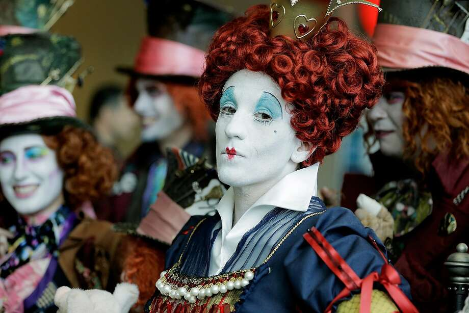 SAN DIEGO, CA - JULY 24: Lori Ouellette, of Cheshire, Connecticut, portrays The Red Queen with the group, League of Hatters, during the 45th annual San Diego Comic-Con on July 24, 2014 in San Diego, California. An estimated 130,000 attendees are expected at this year's convention, which will celebrate the 75th anniversary of both Marvel Comics and the first Batman comic book. (Photo by T.J. Kirkpatrick/Getty Images) Photo: T.J. Kirkpatrick, Getty Images