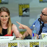 """Actors Gillian Jacobs (L) and Jim Rash attend """"Community"""" panel during Comic-Con International 2014 at the San Diego Convention Center on July 24, 2014 in San Diego, California."""
