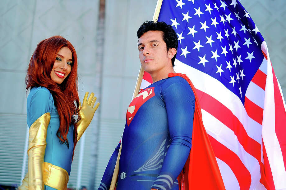 Belinda Sainz, left, and Bersain Gutierrez, both of San Diego, CA, portray the characters Phoenix and Superman during the 45th annual San Diego Comic-Con on July 24, 2014 in San Diego, California. An estimated 130,000 attendees are expected at this year's convention, which will celebrate the 75th anniversary of both Marvel Comics and the first Batman comic book. Photo: T.J. Kirkpatrick, Getty Images / 2014 Getty Images