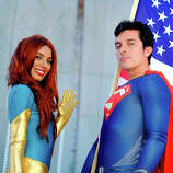 Belinda Sainz, left, and Bersain Gutierrez, both of San Diego, CA, portray the characters Phoenix and Superman during the 45th annual San Diego Comic-Con on July 24, 2014 in San Diego, California. An estimated 130,000 attendees are expected at this year's convention, which will celebrate the 75th anniversary of both Marvel Comics and the first Batman comic book.