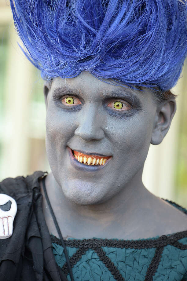An attendee dressed as the Disney vilian Hades the first day of the 45th annual San Diego Comic-Con, in San Diego California July 24, 2014.  The four-day pop culture extravaganza celebrates film, TV, video games, comic books, costumes and other popular arts. More than 150,000 fans are expected to attend the sold-out event. Photo: ROBYN BECK, AFP/Getty Images / AFP