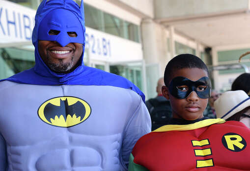 Erien Hodge and his son Adonis Hodge, 13, are dressed as Batman and Robin on the first day of the 45th annual San Diego Comic-Con, in San Diego California July 24, 2014.  The four-day pop culture extravaganza celebrates film, TV, video games, comic books, costumes and other popular arts. More than 150,000 fans are expected to attend the sold-out event. Photo: ROBYN BECK, AFP/Getty Images / AFP