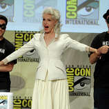 """Actress Julie Newmar (C) attends the """"Batman: The Complete Series"""" DVD release presentation during Comic-Con International 2014 at the San Diego Convention Center on July 24, 2014 in San Diego, California."""