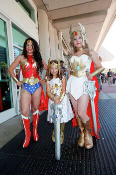 (L-R) Costumed fans Nicole Kiss, Alexa Kiss, and Nicolle Hanbury pose for photos outside the San Diego Convention Center on July 24, 2014 in San Diego, California. Photo: Daniel Knighton, WireImage / 2014 Daniel Knighton
