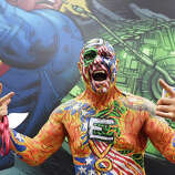 """An attendee called """"Nomad"""" of the group Dive Bomber poses on the first day of the 45th annual Comic-Con in San Diego, California on July 24, 2014 at the San Diego Convention Center.  The four-day pop culture extravaganza celebrates film, TV, video games, comic books, costumes and other popular arts. More than 150,000 fans were expected to attend the sold-out event."""